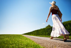 Young woman walking fast on a road Royalty Free Stock Images