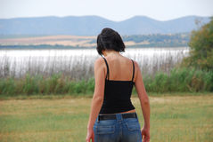 Young woman walking in the field Royalty Free Stock Photos