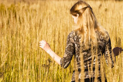 Young woman walking in a field Royalty Free Stock Photo
