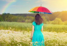 Young woman walking on the field stock photography