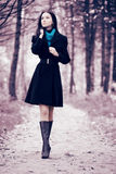 Young woman walking in forest Royalty Free Stock Images