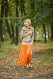 Young woman walking in forest Royalty Free Stock Photography