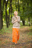 Young woman walking in forest Stock Photography