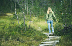 Young Woman walking in forest wooden road alone Stock Image