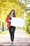 Young woman walking Stock Photography