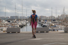 Young woman walking in harbor Stock Photography