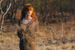 Free Young Woman Walking In Golden Dried Grass Field Royalty Free Stock Photography - 41179317