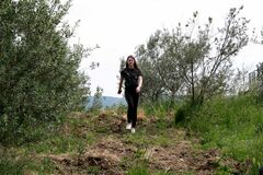 Free Young Woman Walking In Nature Between Olive Trees Royalty Free Stock Photo - 183248095