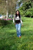 Young Woman Walking In Park Royalty Free Stock Images