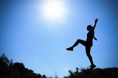 Young Woman Walking In The Sun Royalty Free Stock Photography
