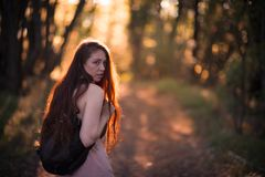 Free Young Woman Walking In Woods Stock Images - 107600714