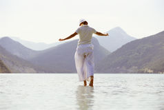 Young woman walking in lake royalty free stock photography
