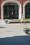 The Young woman walking on Lavrushinsky Lane Stock Image