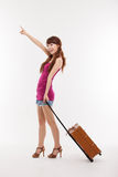 Young woman walking with luggage. Stock Photography