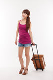 Young woman walking with luggage. Stock Photo