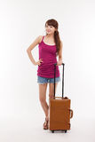 Young woman walking with luggage. Royalty Free Stock Photo
