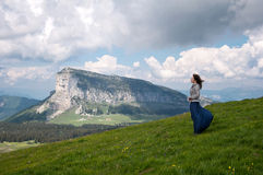 Young woman walking in the mountains. Alps Royalty Free Stock Photo