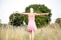 Young woman walking in nature Royalty Free Stock Photos