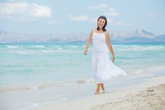 Young woman walking near blue sea. Royalty Free Stock Photos