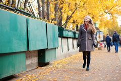 Young woman walking near bookseller boxes. In Paris royalty free stock photo