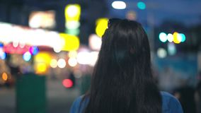 Young woman walking in the night city. Back view concept.  stock footage