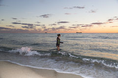 Young Woman Walking in the Ocean Royalty Free Stock Images