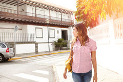 Young woman walking outdoors and looking away Royalty Free Stock Images
