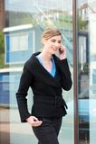 Young woman walking outdoors with mobile phone Stock Photography