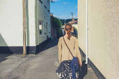 Young woman walking outside royalty free stock photography