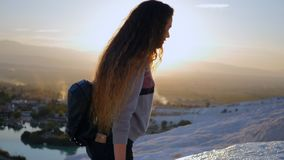 Young woman walking in Pamukkale terraces. Portrait of young woman walking in Cotton Castle limestone terraces in Pamukkale Turkey during beautiful sunset stock footage