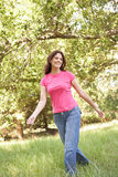Young Woman Walking Through Park Royalty Free Stock Photo