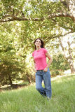 Young Woman Walking Through Park Royalty Free Stock Photography