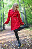 Young woman walking in park. Camera angle view Royalty Free Stock Image