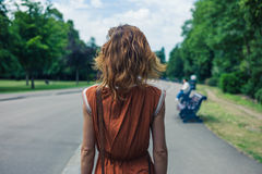 Young woman walking in park. A young woman is walking in a park Royalty Free Stock Images