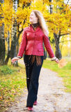 Young woman walking in a park. Autumn season Royalty Free Stock Images
