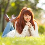 Young woman walking in the park. Beauty nature scene royalty free stock photography