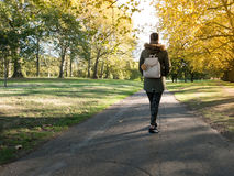 Young woman walking in the park Royalty Free Stock Photography