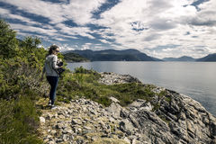 Young woman walking in the park, Norway. Young woman walking in the park next to the fjord, Norway Royalty Free Stock Image