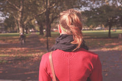 Young woman walking in the park Stock Photography