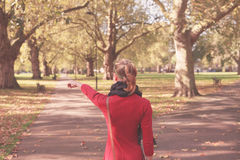 Young woman walking in the park Stock Image