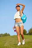 Young woman walking in the park. In summer Royalty Free Stock Images