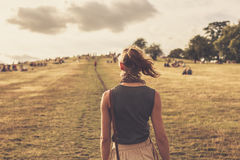Young woman walking in the park at sunset Royalty Free Stock Images