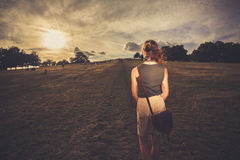 Young woman walking in the park at sunset Royalty Free Stock Photos