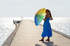 Young woman walking on the pier  Royalty Free Stock Photography