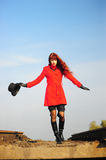 Young woman walking by railway Stock Images