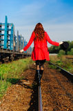 Young woman walking by railway Stock Image