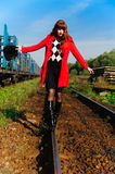 Young woman walking by railway Royalty Free Stock Photos