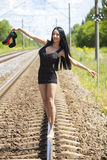 Young Woman is Walking on Railway Tracks Royalty Free Stock Photos
