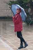 Young woman walking in the rain Stock Photography