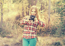 Young Woman walking with retro photo camera outdoor Lifestyle Stock Photo